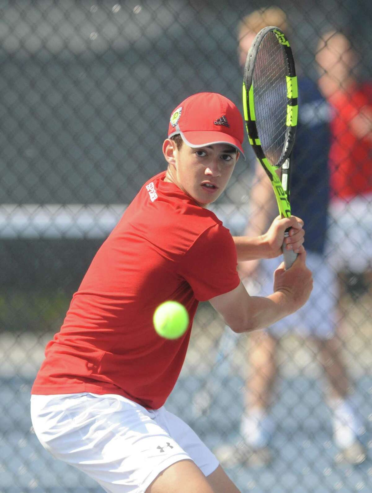 Justin Speaker competes at No. 1 singles for Greenwich.
