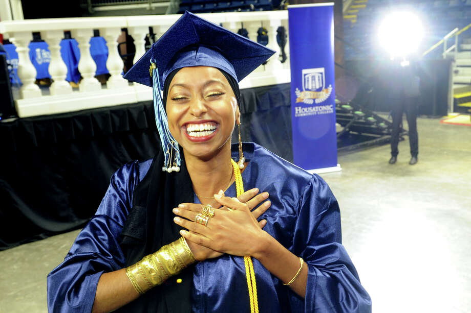 Ahlaam Abduljalil, of Bridgeport, celebrates during Commencement for the Housatonic Community College graduating Class of 2018 at the Webster Bank Arena, in Bridgeport, Conn. May 24, 2018. Photo: Ned Gerard, Hearst Connecticut Media / Connecticut Post