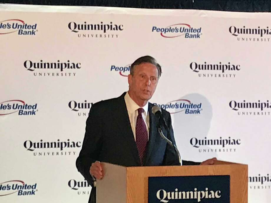 Quinnipiac University President John Lahey announces a $10 million agreement between the Hamden-based school and People United Bank. Photo: Luther Turmelle / Hearst Connecticut Media