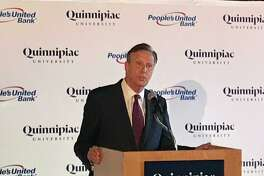 Quinnipiac University President John Lahey announces a $10 million agreement between the Hamden-based school and People United Bank.