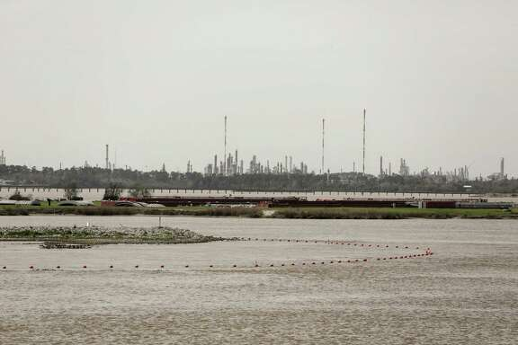 This March 1, 2018 photo shows the orange buoys marking the boundaries of the San Jacinto Waste Pits in Highlands, Texas. An agreement announced last month has cleared the way for the waste pits to be cleaned up, but dioxin damage already has spread far beyond them, the Houston Chronicle and The Associated Press found.