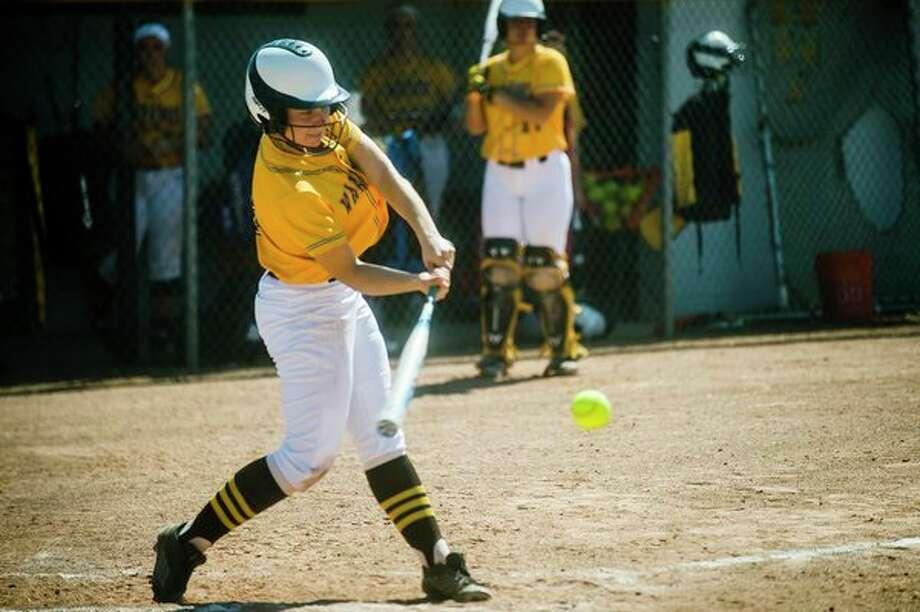 Bay City Western's Olivia Kowalski swings on a pitch during a game against Bay City John Glenn on Thursday at Western High School. (Katy Kildee/kkildee@mdn.net)