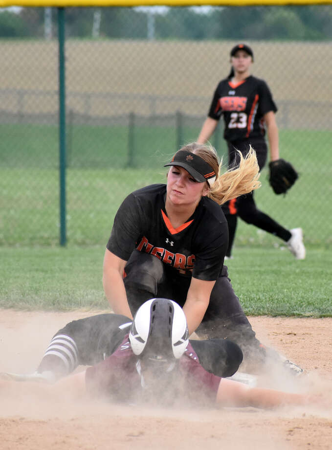 Edwardsville's Emma Lewis tags out a Belleville West runner at second base.