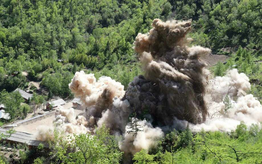 In this Thursday, May 24, 2018 photo, The fourth tunnel of North Korea's nuclear test site is blown up in Punggye-ri, North Korea. North Korean leader Kim Jong Un made good on his promise to demolish his country's nuclear test site, which was formally closed in a series of huge explosions Thursday as a group of foreign journalists looked on. (Korea Pool/Yonhap via AP) Photo: AP / Korea Pool via Yonhap