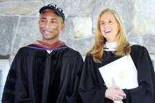 "Commencement speaker Pharrell Williams, left, with Greenwich Academy Head of School Molly King during the commencement at the school in Greenwich, Conn., Thursday, May 24, 2018. Williams is a singer, rapper and record producer and is best known for his 2013 hit song ""Happy."""