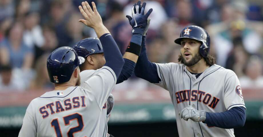 Houston Astros' Jake Marisnick, right, is congratulated by Yuli Gurriel and Max Stassi after all three scored on a three-run home run during the sixth inning of a baseball game against the Cleveland Indians, Thursday, May 24, 2018, in Cleveland. (AP Photo/Tony Dejak) Photo: Tony Dejak/Associated Press