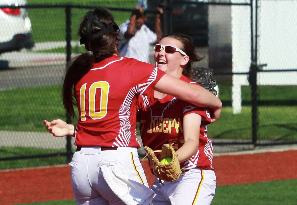 St. Jospeh's Payton Doiron (10) and teammate Madison Fitzgerald (24) celebrate after the team beat Fairfield Ludlowe in FCIAC softball semi-final action at Sacred Heart University in Fairfield, Conn., on Thursday May 24, 2018.
