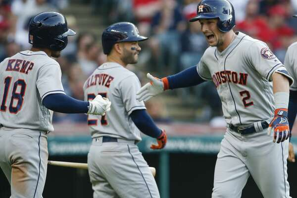 CLEVELAND, OH - MAY 24: Alex Bregman #2 of the Houston Astros celebrates with Jose Altuve #27 and Tony Kemp #18 after hitting a three run home run off Mike Clevinger #52 of the Cleveland Indians during the fifth inning at Progressive Field on May 24, 2018 in Cleveland, Ohio. The Astros defeated the Indians 8-2. (Photo by Ron Schwane/Getty Images)