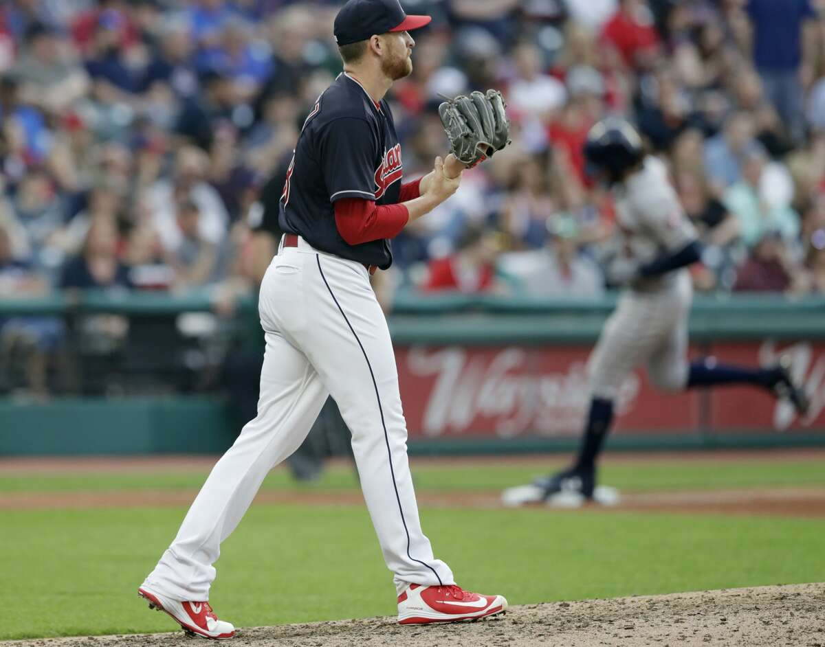 Cleveland Indians relief pitcher Neil Ramirez, left, waits for Houston Astros' Jake Marisnick to run the bases after Marisnick hit a three-run home run in the sixth inning of a baseball game Thursday, May 24, 2018, in Cleveland. (AP Photo/Tony Dejak)