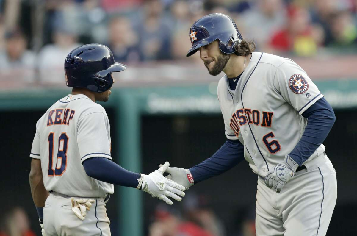 Houston Astros' Jake Marisnick (6) is congratulated by Tony Kemp after Marisnick hit a three-run home run in the sixth inning of a baseball game against the Cleveland Indians, Thursday, May 24, 2018, in Cleveland. (AP Photo/Tony Dejak)