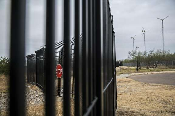 FILE -- A portion of the border fence along the edge of Laredo Community College's campus in Laredo, Texas, Jan. 27, 2017. A Border Patrol agent shot and killed a woman who had crossed the border illegally near Laredo on May 23, 2018, after the officer came under attack, federal authorities said. The officer said he fired his gun because he had been assaulted, but a neighbor said there were no signs of an attack. (Tamir Kalifa/The New York Times)
