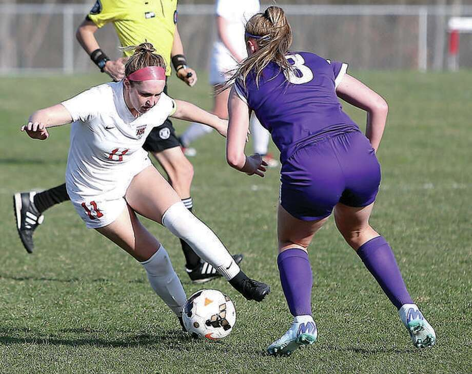 Alton's Brianna Hatfield (11) repeated as an Illinois High School Soccer Coaches Association All-State selection in voting that was announced Thursday. She is shown in action against Collinsville earlier this season.