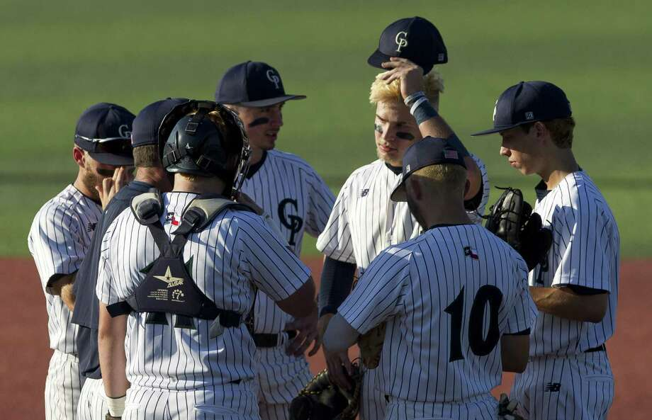 College Park head coach Jason Washburn talks with players in the third inning of Game 1 during a Region II-6A semifinal series at Sam Houston State University, Thursday, May 24, 2018, in Huntsville. Photo: Jason Fochtman, Staff Photographer / Houston Chronicle / © 2018 Houston Chronicle