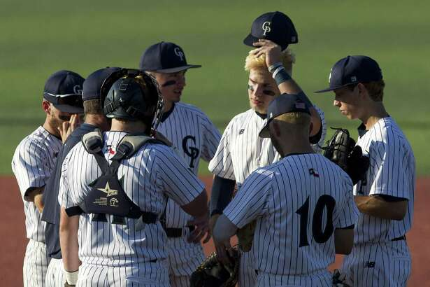 College Park head coach Jason Washburn talks with players in the third inning of Game 1 during a Region II-6A semifinal series at Sam Houston State University, Thursday, May 24, 2018, in Huntsville.