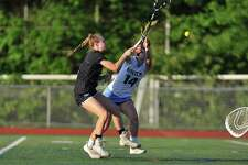 Darien's Emma Jaques shoots and scores during the FCIAC championship game against Wilton on Thursday.