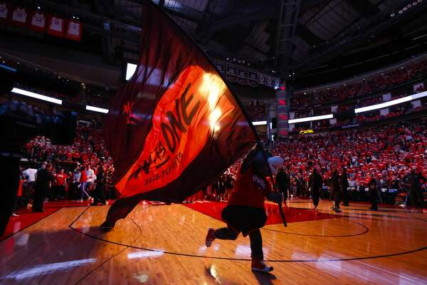 Clutch brings out a flag before the first half of Game 5 of the NBA Western Conference Finals at Toyota Center on Thursday, May 24, 2018, in Houston. ( Brett Coomer / Houston Chronicle )