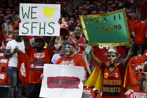 Fans cheer for Santa Fe students and staff before Game 5 of the NBA Western Conference Finals at Toyota Center on Thursday, May 24, 2018, in Houston. ( Brett Coomer / Houston Chronicle )