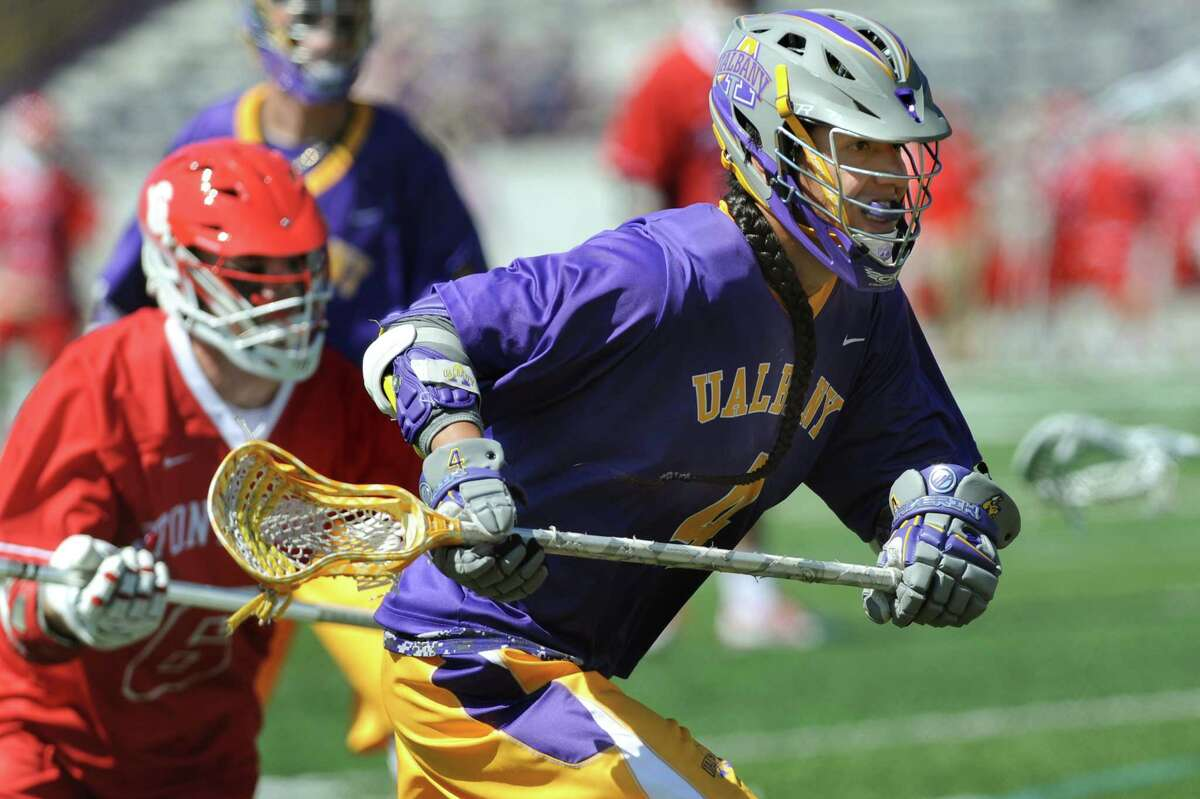 UAlbany's Lyle Thompson, right, chases a ball during the America East Conference championship lacrosse game against Stony Brook in 2015. Thompson said he's going to enjoy looking around the campus at UAlbany, which he hasn't been back to since he graduated.