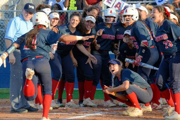 The Eagles react to a home run hit by London Marder (21) during the fourth inning in Game 1 of a 6A-III regional final playoff game between the Katy Tigers and the Atascocita Eagles on Thursday May 24, 2018 at Tompkins HS, Katy, TX.