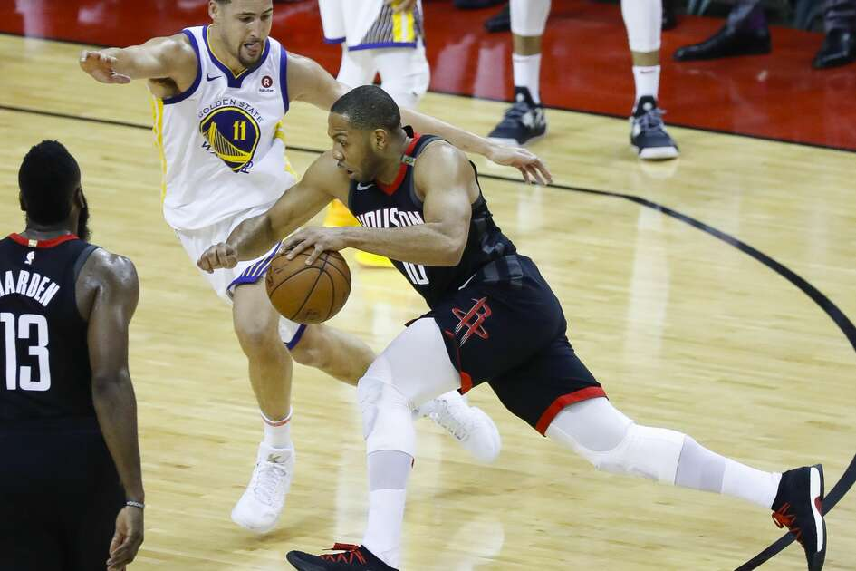 Houston Rockets guard Eric Gordon (10) drives around Golden State Warriors guard Klay Thompson (11) during the first half of Game 5 of the Western Conference Finals at Toyota Center, Thursday, May 24, 2018, in Houston.  ( Karen Warren  / Houston Chronicle )