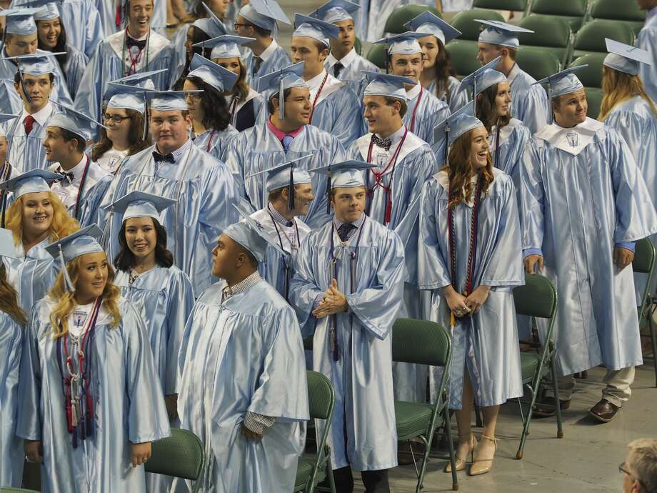 Greenwood seniors make their way in during the processional 05/24/18 evening for the class of 2018 Commencement ceremony at the Chaparral Center. Tim Fischer/Reporter-Telegram Photo: Tim Fischer/Midland Reporter-Telegram