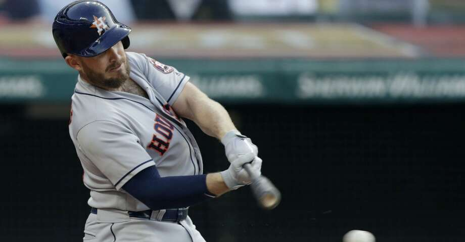 Houston Astros' Max Stassi hits an RBI-single off Cleveland Indians relief pitcher Tyler Olson in the sixth inning of a baseball game, Thursday, May 24, 2018, in Cleveland. Carlos Correa scored on the play. (AP Photo/Tony Dejak) Photo: Tony Dejak/Associated Press