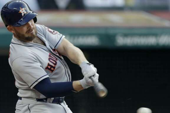 Houston Astros' Max Stassi hits an RBI-single off Cleveland Indians relief pitcher Tyler Olson in the sixth inning of a baseball game, Thursday, May 24, 2018, in Cleveland. Carlos Correa scored on the play. (AP Photo/Tony Dejak)