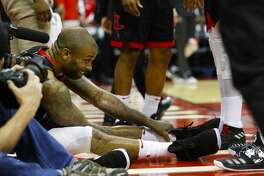 Houston Rockets forward PJ Tucker (4) sits on the ground after a play during the second half of Game 5 of the NBA Western Conference Finals at Toyota Center on Thursday, May 24, 2018, in Houston. ( Brett Coomer / Houston Chronicle )