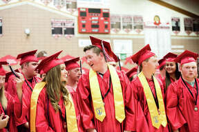 Graduates react as their commencement draws to a close at Beaverton High School on Thursday, May 24, 2018. (Danielle McGrew Tenbusch/for the Daily News)
