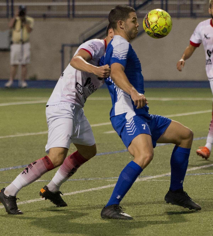 Sockers FC foward Maximilliano Galizzi tries to control the ball as Laredo Heat's Younes Boudadi defends 05/24/18 evening at Grande Communications Stadium. Tim Fischer/Reporter-Telegram