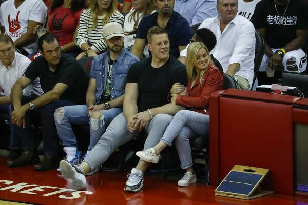 Justin Timberlake, J.J. Watt and Kealia Ohai watch Game 5 of the Western Conference Finals at Toyota Center, Thursday, May 24, 2018, in Houston.  ( Karen Warren  / Houston Chronicle )