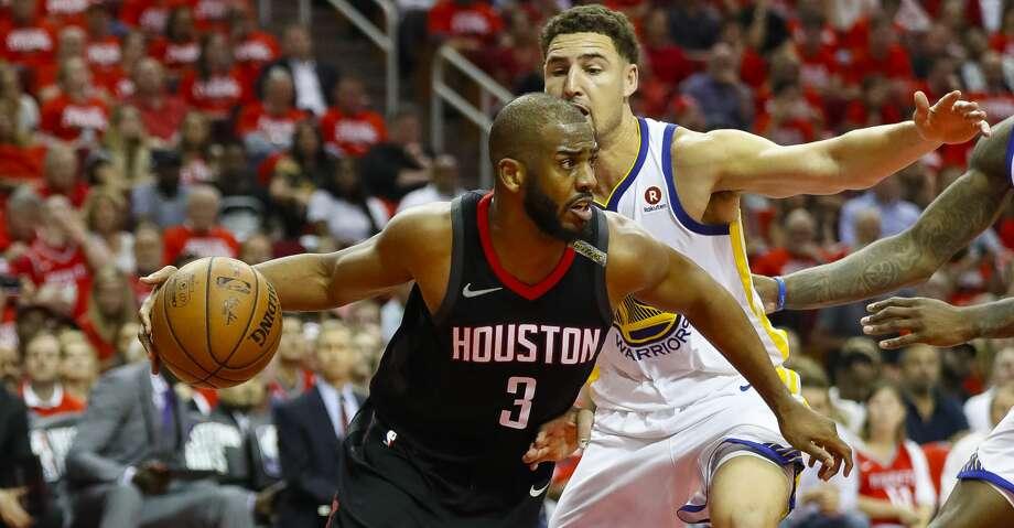 2b9dde50522f Houston Rockets guard Chris Paul (3) drives around Golden State Warriors  guard Klay Thompson