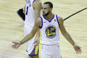 Golden State Warriors guard Stephen Curry (30) reacts during the first half of Game 5 of the Western Conference Finals at Toyota Center, Thursday, May 24, 2018, in Houston.