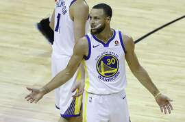 Golden State Warriors guard Stephen Curry (30) reacts during the first half of Game 5 of the Western Conference Finals at Toyota Center, Thursday, May 24, 2018, in Houston.  ( Karen Warren  / Houston Chronicle )