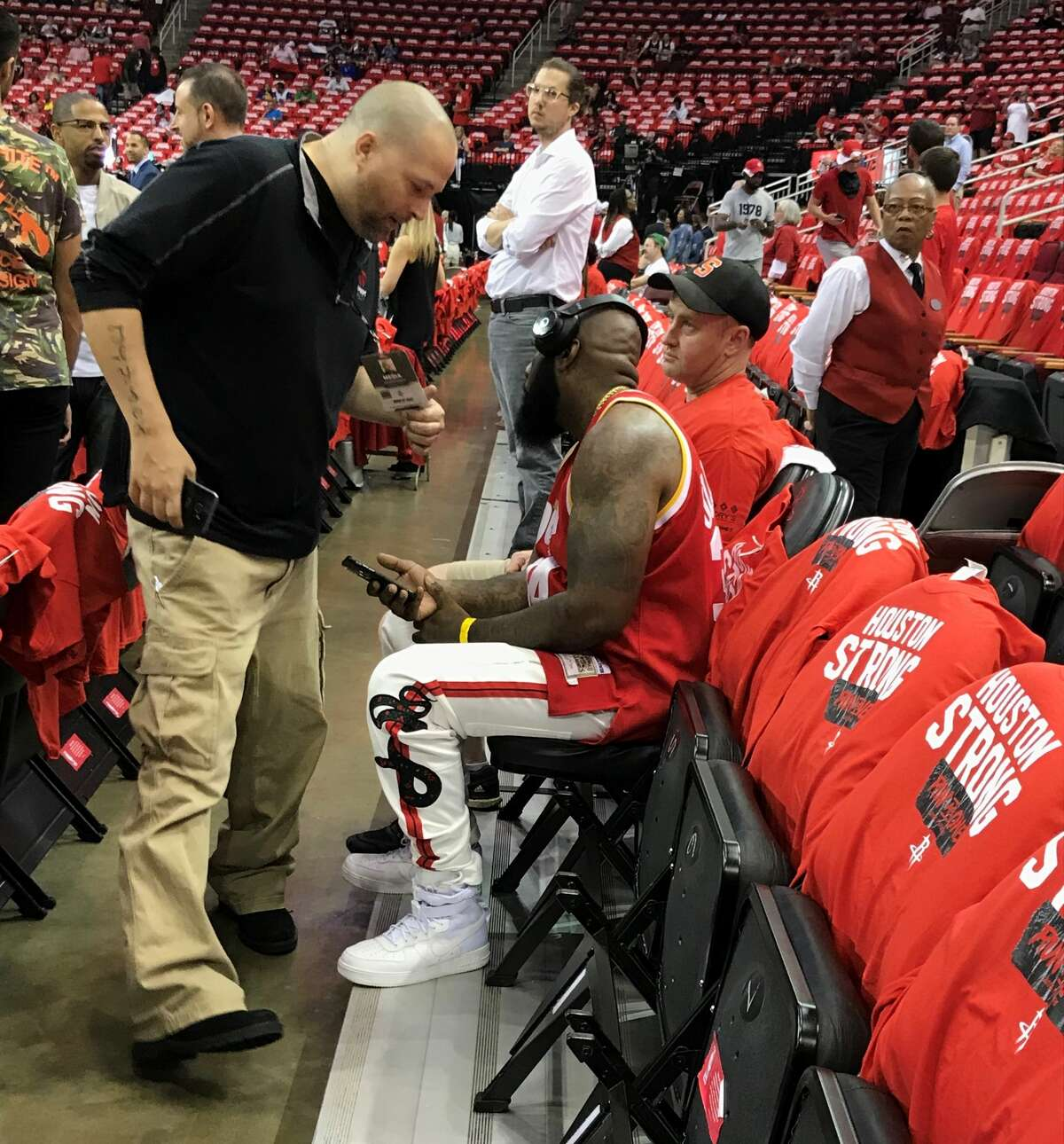 Rapper Trae tha Truth (seated) talks with 790 AM's Jayson Braddock (left) before Game 5 of the Rockets-Warriors Western Conference finals on Thursday, May 24, 2018 at Toyota Center.