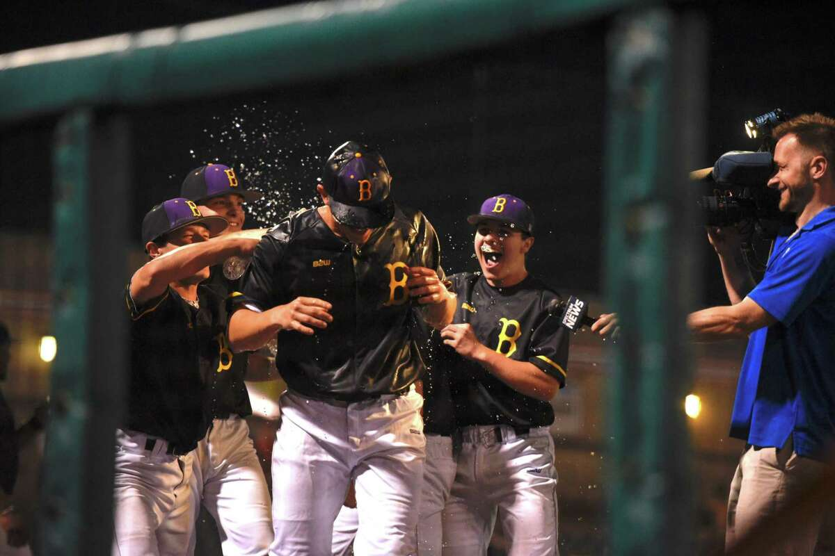 Ballston Spa's Luke Gold gets doused with water during an interview after the team won the Section II Class AA semifinal baseball game against Shenendehowa at Bruno Stadium in Troy, N.Y., on Thursday, May 24, 2018. (Eric Jenks / Special to the Times Union)