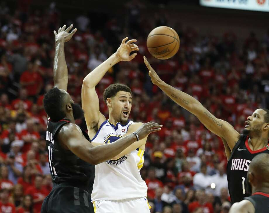 Golden State Warriors guard Klay Thompson (11) tries to pass through Houston Rockets guard James Harden (13) and Houston Rockets forward Trevor Ariza (1) during the second half of Game 5 of the NBA Western Conference Finals at Toyota Center on Thursday, May 24, 2018, in Houston. ( Brett Coomer / Houston Chronicle ) Photo: Brett Coomer/Houston Chronicle