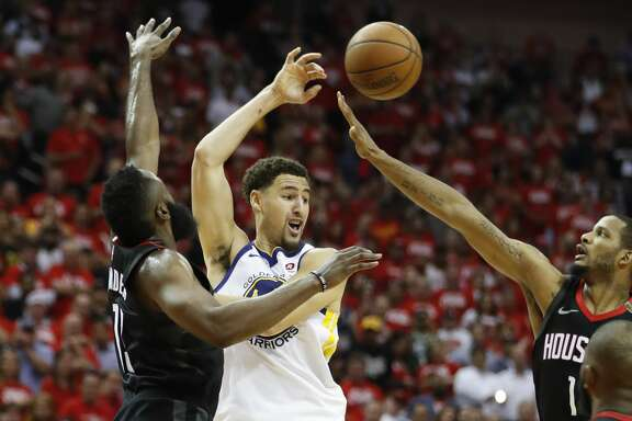 Golden State Warriors guard Klay Thompson (11) tries to pass through Houston Rockets guard James Harden (13) and Houston Rockets forward Trevor Ariza (1) during the second half of Game 5 of the NBA Western Conference Finals at Toyota Center on Thursday, May 24, 2018, in Houston. ( Brett Coomer / Houston Chronicle )