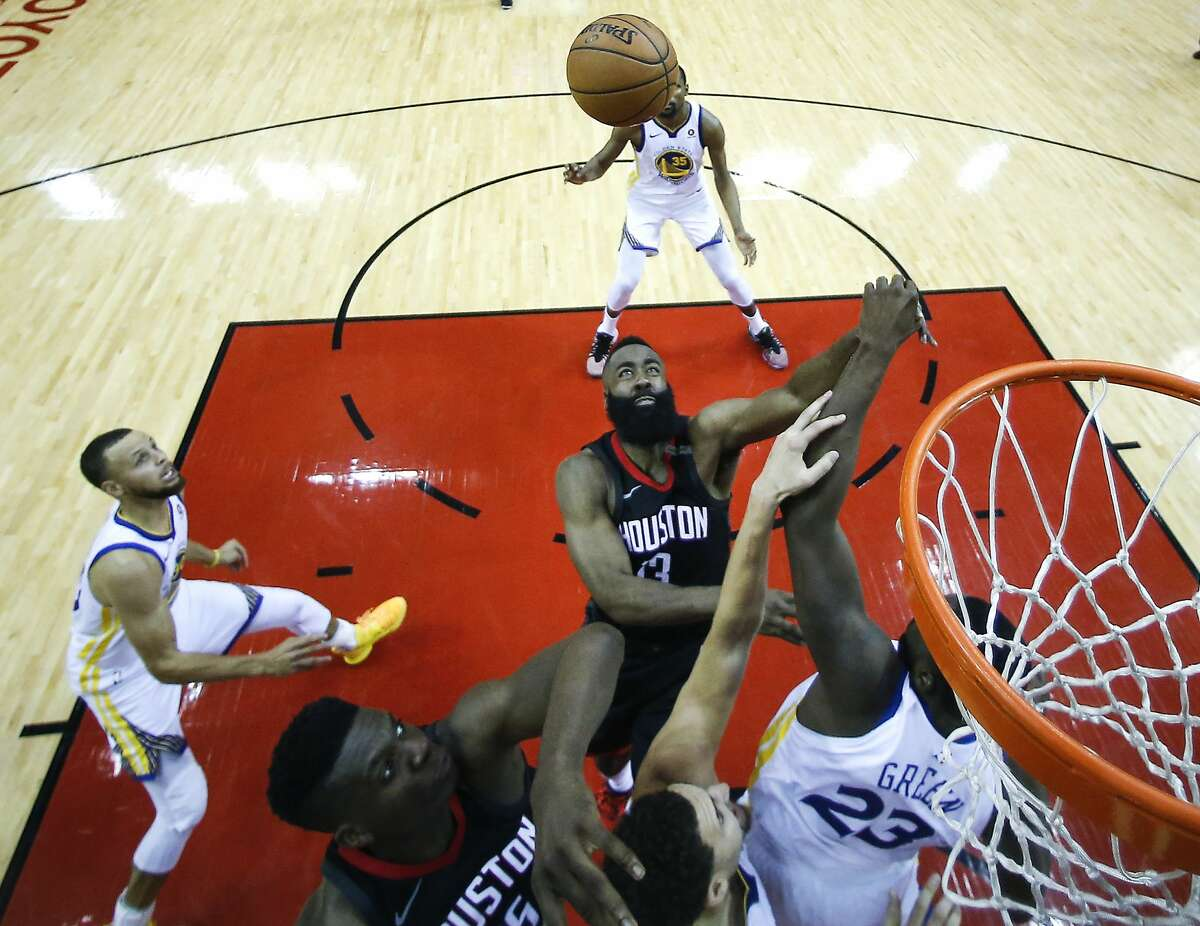 Houston Rockets guard James Harden (13) takes a shot over Golden State Warriors forward Draymond Green (23) during the second half of Game 5 of the NBA Western Conference Finals at Toyota Center on Thursday, May 24, 2018, in Houston. ( Brett Coomer / Houston Chronicle )