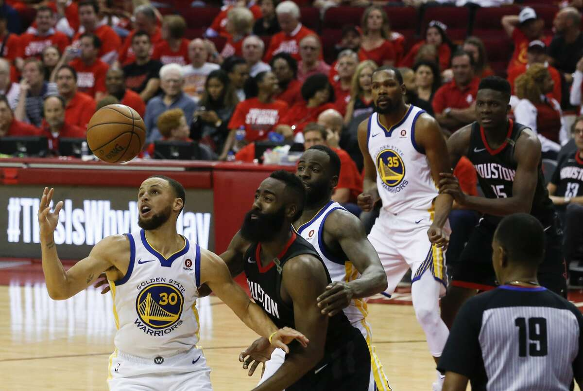Golden State Warriors guard Stephen Curry (30) scrambles for a loose ball during Game 5 of the Western Conference Finals at Toyota Center, Thursday, May 24, 2018, in Houston. ( Karen Warren / Houston Chronicle )