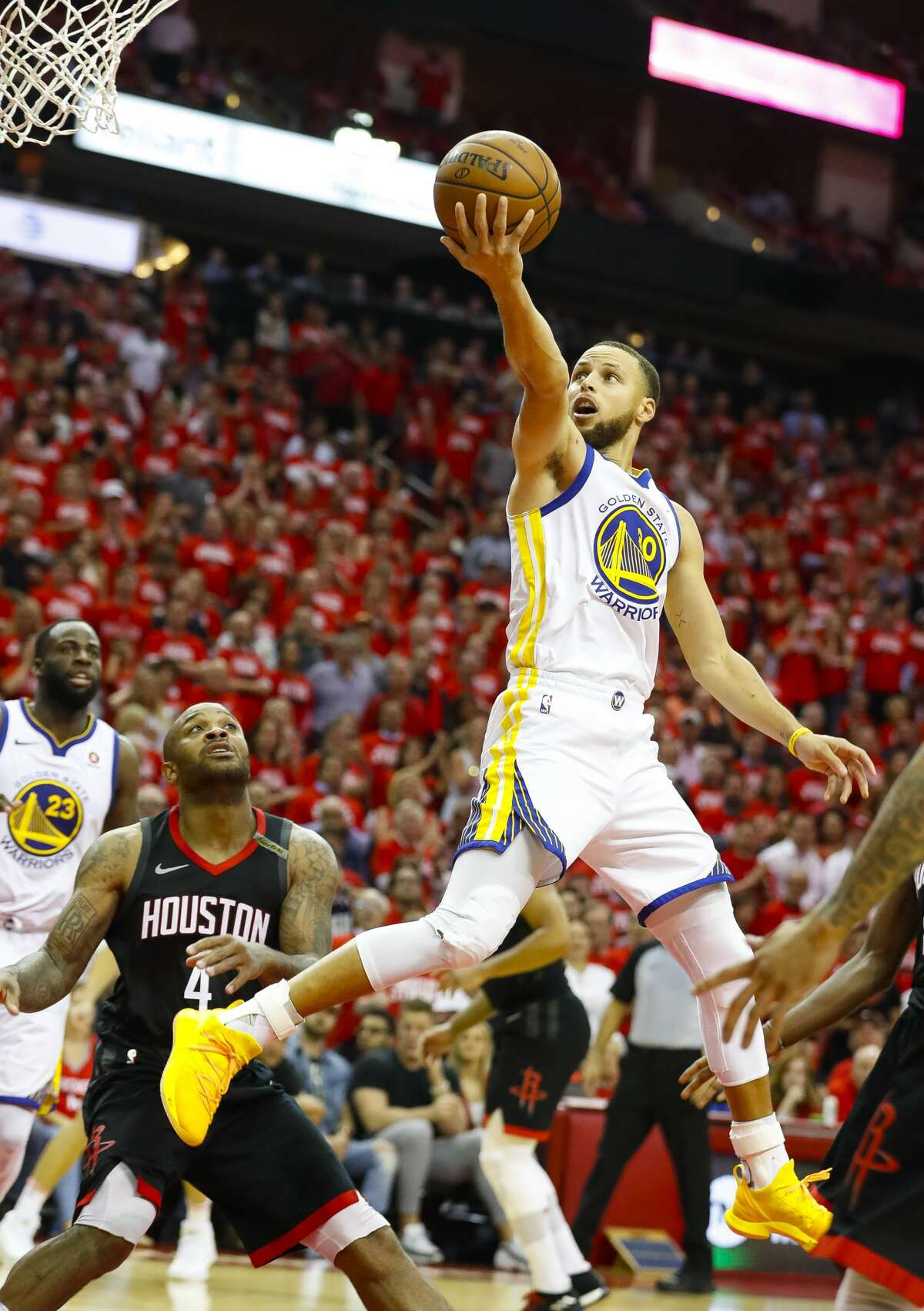 Golden State Warriors guard Stephen Curry (30) shoots over Houston Rockets forward PJ Tucker (4) during the second half of Game 5 of the NBA Western Conference Finals at Toyota Center on Thursday, May 24, 2018, in Houston. ( Brett Coomer / Houston Chronicle )