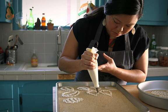Sita Bhaumik�makes a traditional west Bengali pastry made for special occasions known as Gayna Bori a decorative savory pastry made out of lentil flour.�Oakland February 27th, 2018.
