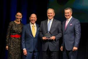 Sue and Lester Smith with President George W. Bush and Gary Markowitz