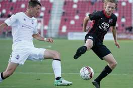 SAFC midfielder and San Antonio native Ethan Bryant plays the ball in front of a Colorado Springs FC player on Wednesday.