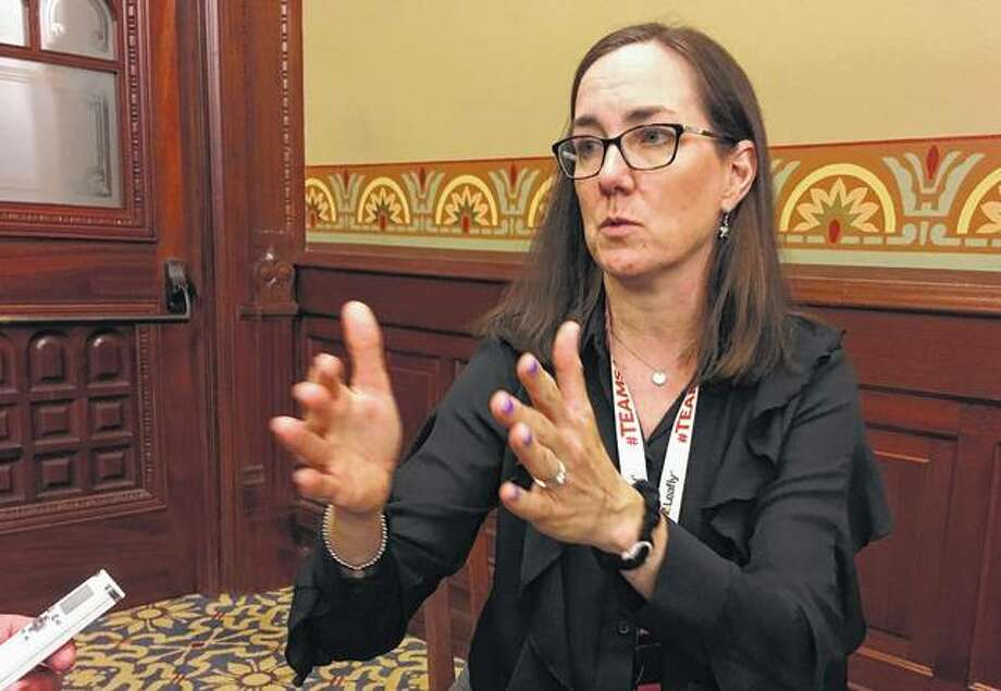 Chicago Democratic state Rep. Kelly Cassidy speaks to a reporter Thursday at the Capitol in Springfield. Cassidy has said the process for investigating ethics complaints in the Legislature should be overhauled. Photo:       John O'Connor | Associated Press