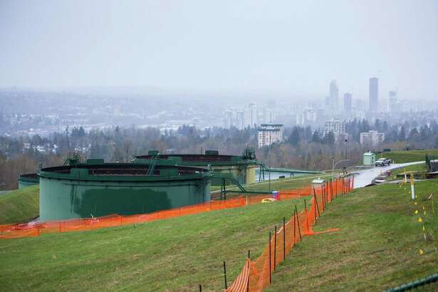 Oil tanks stand near the Kinder Morgan Trans Mountain pipeline expansion site in Burnaby, B.C.