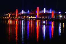 "The Pearl Harbor Memorial Bridge in New Haven, more commonly referred to as the Q Bridge by area residents and resembles a battleship, illuminates the sky in the patriotic colors of red, white and blue, Wednesday, Dec. 6, 2017, marking the surprise attack on the United States Naval Base at Pearl Harbor by the Imperial Japanese Navy Air Service on December 7, 1941. The bombing killed more than 2,300 Americans and destroyed the American battleship U.S.S. Arizona and capsized the U.S.S. Oklahoma. President Franklin Delano Roosevelt called December 7, 1941, ""a date which will live in infamy."""
