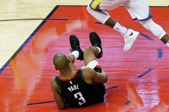 HOUSTON, TX - MAY 24:  Chris Paul #3 of the Houston Rockets grabs his leg after falling against the Golden State Warriors in the fourth quarter of Game Five of the Western Conference Finals of the 2018 NBA Playoffs at Toyota Center on May 24, 2018 in Houston, Texas.