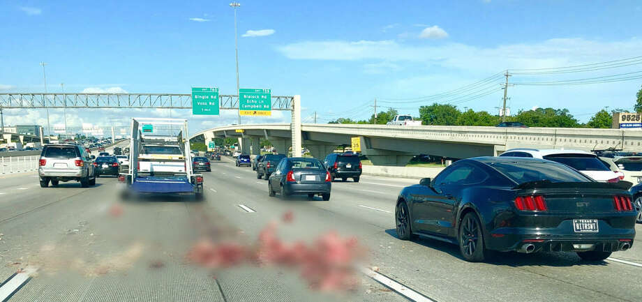 A lost load of butchered pigs made the usual commute along I-10 a little difficult for travelers on Thursday afternoon. The photo has been edited for graphic material.  For memes that make Houston traffic a little more tolerable, see the following gallery Photo: Victoria Childs