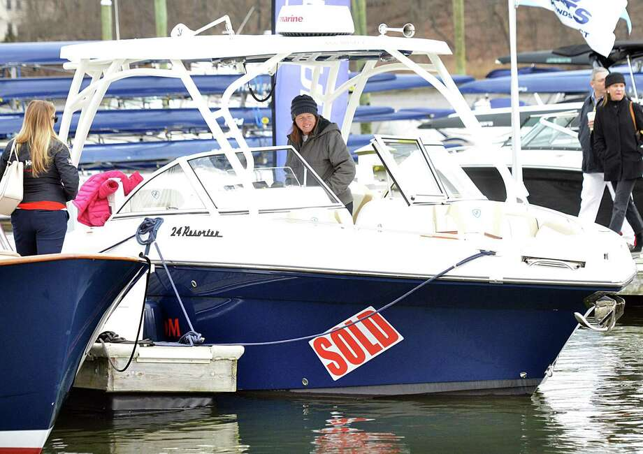 "A ""sold"" sign festoons a boat at the April 2018 Greenwich Boat Show in Greenwich, Conn. As of July, Connecticut is cutting sales tax on boat and engine purchases by half to 3 percent, in a bid to bring back business dealers have lost in the past several years to Rhode Island and New York. Photo: Bob Luckey Jr. / Hearst Connecticut Media / Greenwich Time"